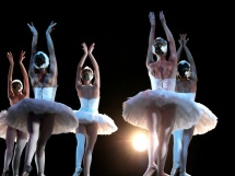 Ballet dancers on stage performing Swan Lake